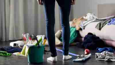 Person standing in front of messy room