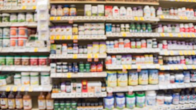 A blurred image of the supplements aisle of a nutrition store.