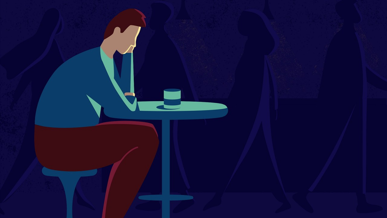 An illustration of a man with ADHD and depression sitting at a table.