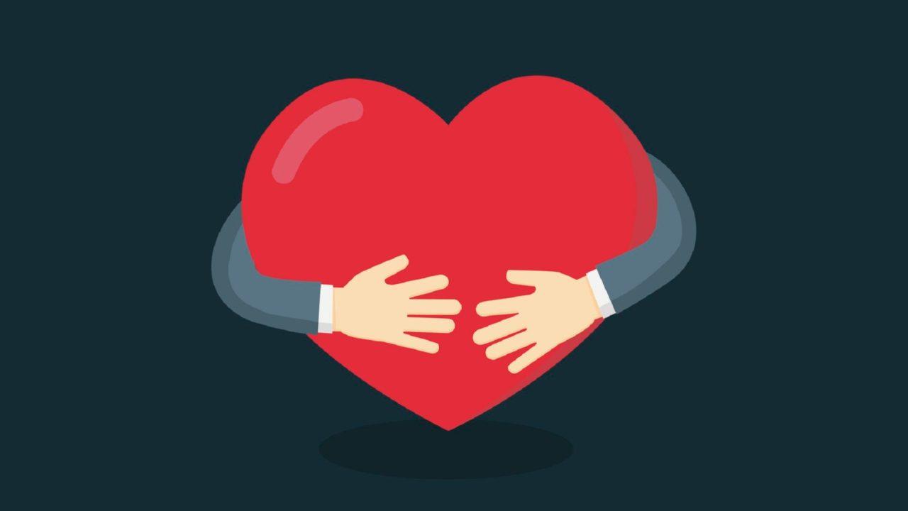 Hands hugging heart