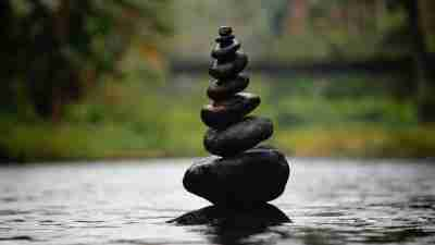 Stacked rocks signifying the time management strategy of doing big tasks first