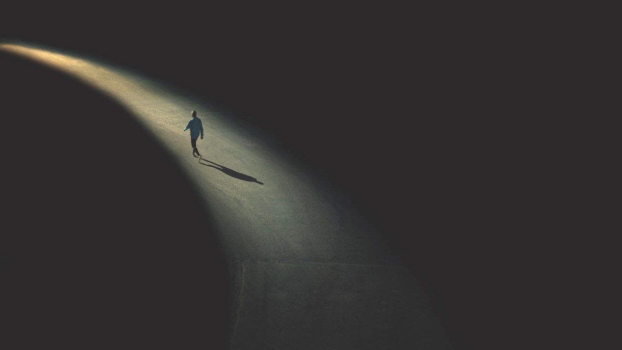 An abstract image of a man walking in the night to demonstrate being different with ADHD
