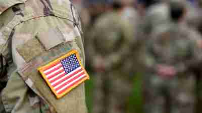 An American flag patch on the shoulder of an U.S. Army soldier