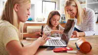 Mother spending time with daughters at home as part of their family schedule