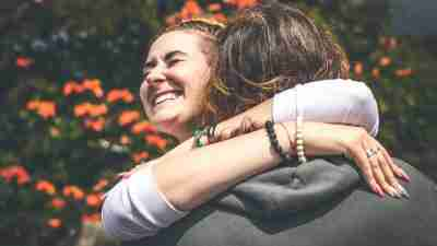 Woman with ADHD hugging a friend