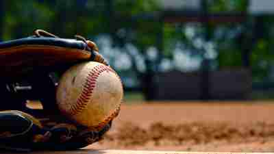 baseball in glove on infield
