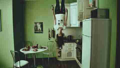 Not back to normal: A woman standing upside down