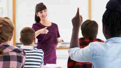 Teacher interacting with students in the classroom
