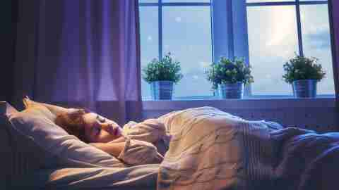 ADHD and sleep problems after medication - a young girl sleeping in bed