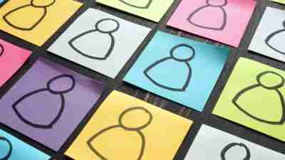 variety concept - icons representing people drawn on post it notes of varying colors