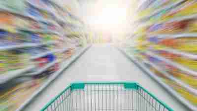 Abstract blurred photo of shopping cart in grocery store