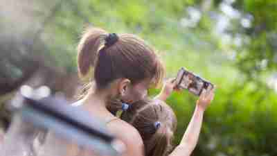 Mom and Daughter Taking Selfie at the park