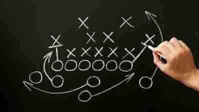 Coach Drawing American Football Playbook Tactics