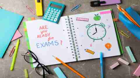 Inscription Are you ready for exams? and stationary on grey background, top view