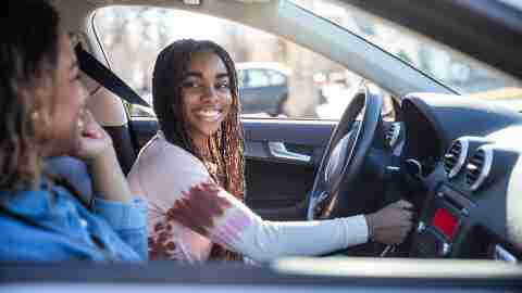 Mother handing car keys to teenage daughter with adhd