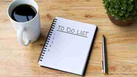 adhd To Do List on Note Pad With Coffee and Pen on Office Desk