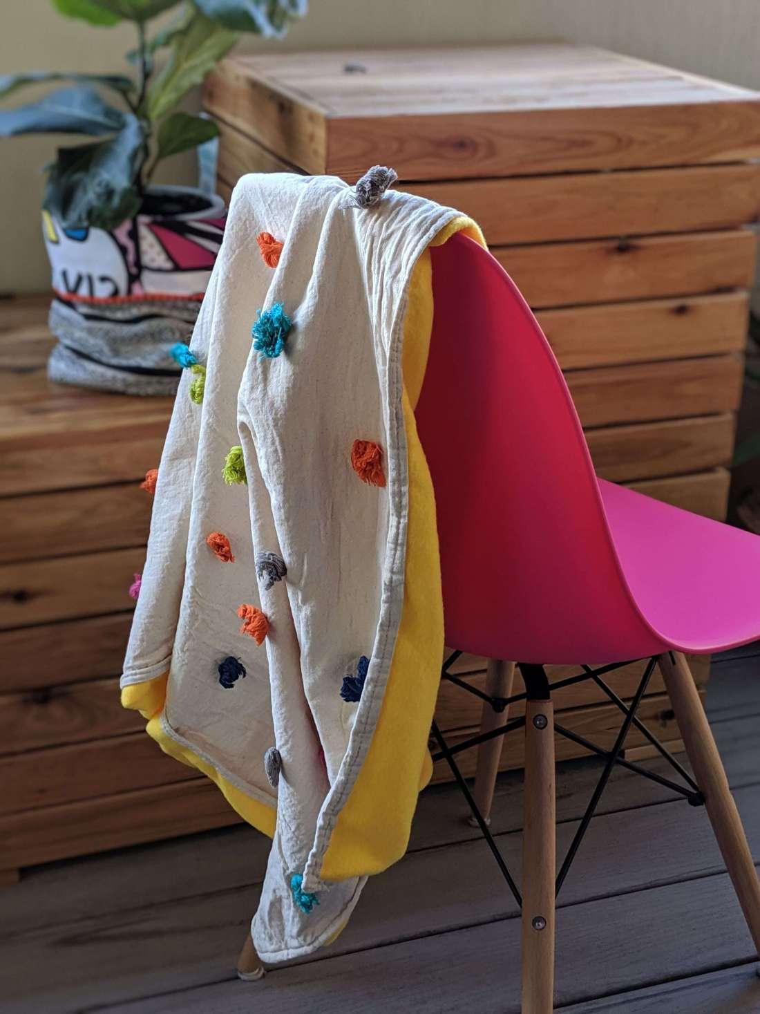yellow pram blanket with tassels