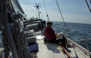Liz reading -enjoying the sail along Erie's south coast