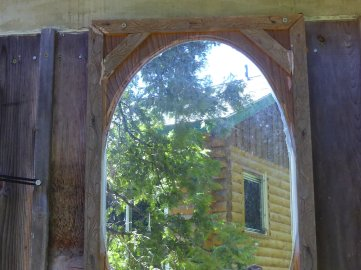 Mirror, mirror on outhouse wall