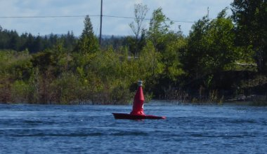 This boat-shaped buoy off the town docks shows boaters which way the current is flowing!