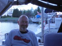 Paul in the cockpit at Roberta Bondar Marina