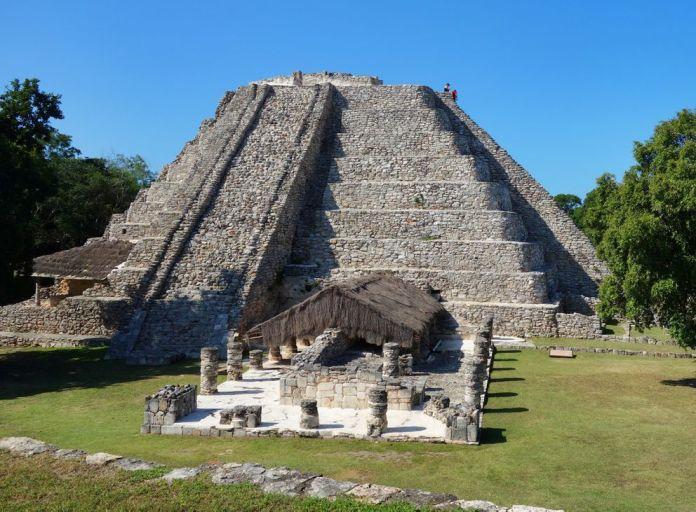 Adventuresome travelers reach the top of the Temple of Kukulcan at the Mayapan ruins near Merida, on Mexico's Yucatan Peninsula. (Scott McMurren)