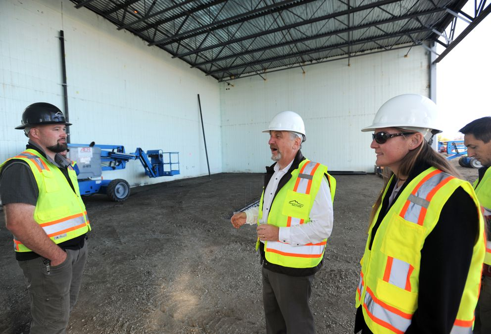 Lake Hood Hangars developer Steve Zelener, center, confers with Remote Alaska Solutions construction company president Seth Kroenke, left, broker and project manager Stormy Jarvis, near right, and construction manager Igor Sapelnik, right, during a visit to the construction site of their first building on Tuesday. (Erik Hill / Alaska Dispatch News)
