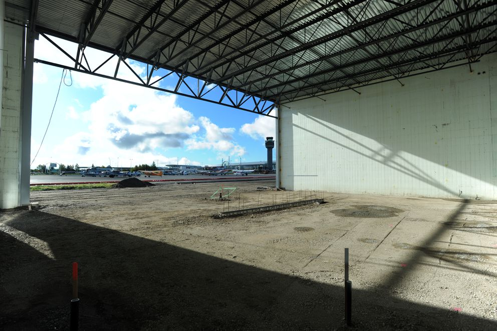 One of six units in the first hangarbuilding currently under construction faces the terminal at Ted Stevens Anchorage International Airport on Tuesday. (Erik Hill / Alaska Dispatch News)