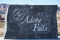 engraved stone Adobe Falls sign