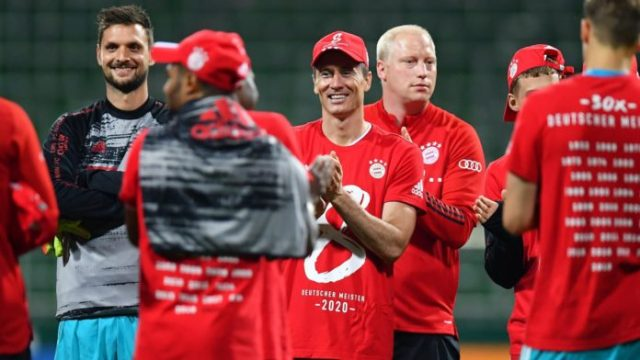 Robert Lewandowski of Bayern Munich wears a shirt and cap in celebration of securing the Bundesliga title following their victory in the Bundesliga match between SV Werder Bremen and FC Bayern Muenchen Image credit: Getty Images