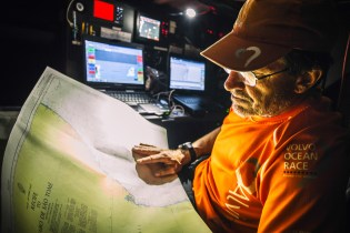 October 25, 2014. Leg 1 onboard Team Alvimedica. Day 14. After rounding Fernando de Noronha off Brazil, the last turning mark on the course until the finish, focus turns to the fast and furious conditions ahead to Cape Town. Navigator Will Oxley still carries traditional paper charts for every potential destination along the course around the world; technology is great when it works but sometimes traditional means are most trustworthy.