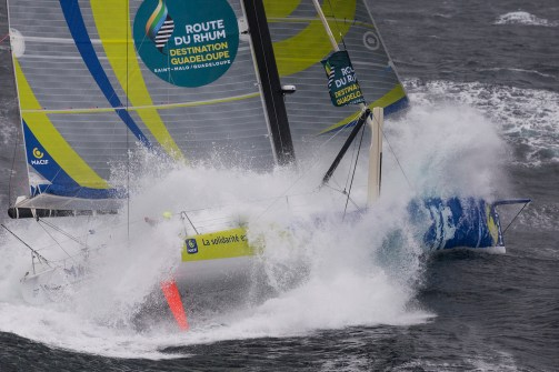 Aerial view of the IMOCA MACIF with french skipper Francois Gabart training in bad weather off Groix Island, south brittany, prior to the Route du Rhum Destination Guadeloupe on october 06, 2014 - Photo Jean Marie Liot / DPPI