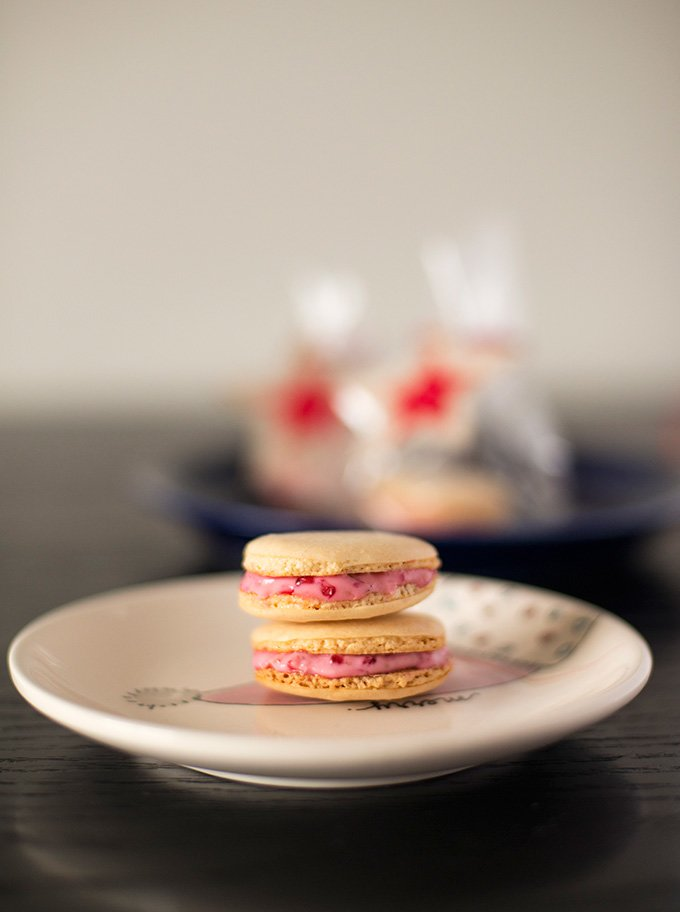 Orange macarons with white chocolate raspberry ganache