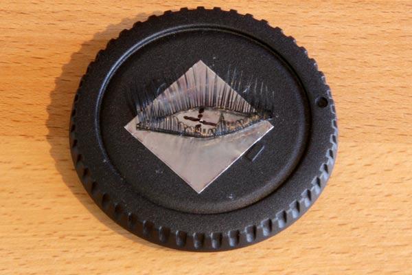 close up of eyelash pinhole lens