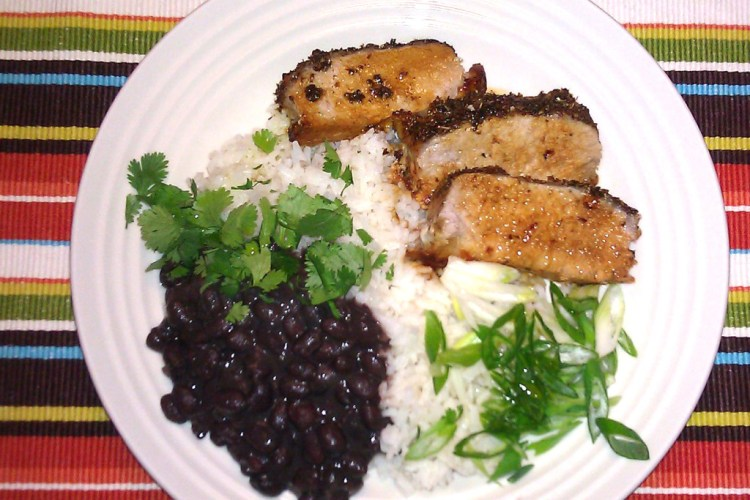 Cuban style pork loin, black beans and white rice with garlic and olive oil