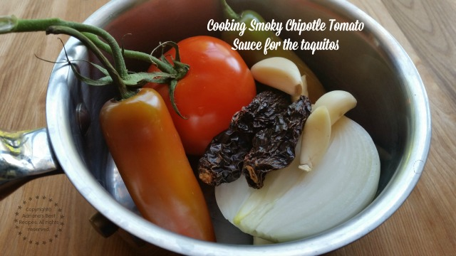 Cooking Smoky Chipotle Tomato Sauce for the taquitos  #ABRecipes