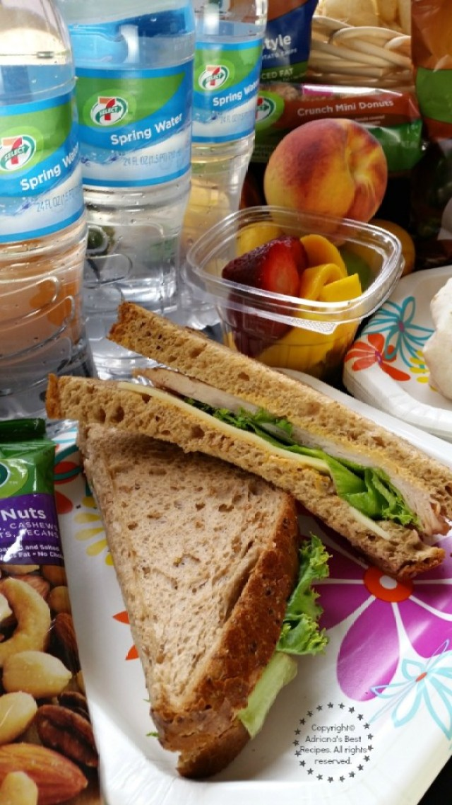 Turkey and cheese sandwich paired with fruit nuts and water #7EFresh #ad