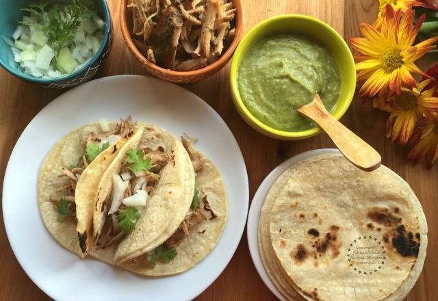 Making delicious Carnitas Tacos with chopped onions, cilantro and serrano guacamole sauce #Porknostico #ad