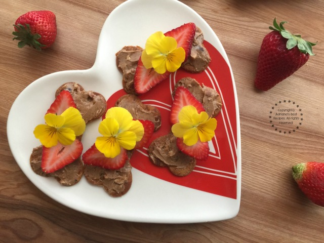 Sweet Bone Treats with almond butter, strawberries and edible pansies
