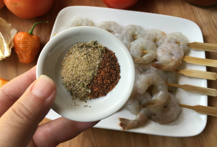 Seasoning the shrimps with sazon latino and hot pepper