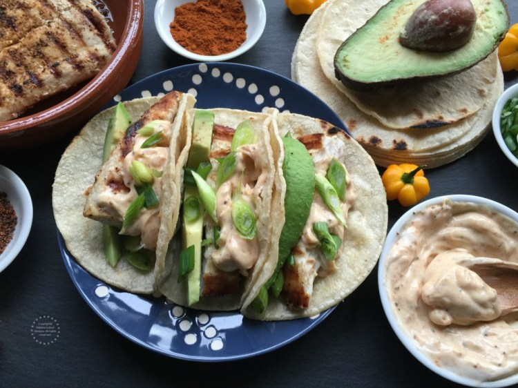 A delightful recipe for grilled fish tacos and a creamy sauce