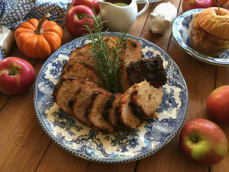 This Chipotle Apple Beer Pork Loin is being paired with oven baked corn stuffing apples