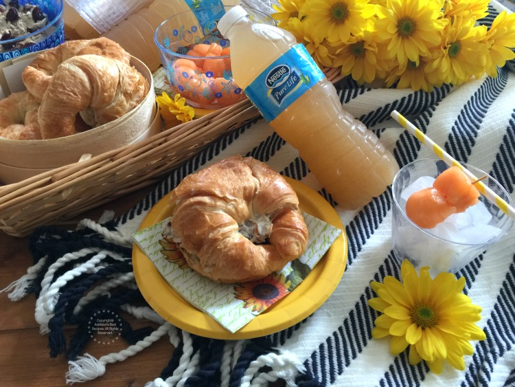 Pairing the lemon basil cantaloupe agua fresca with an almond cherry chicken salad croissant and fresh fruit