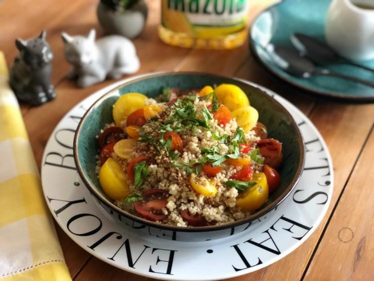 Basil tomato quinoa salad dressed with a light mustard seed vinaigrette