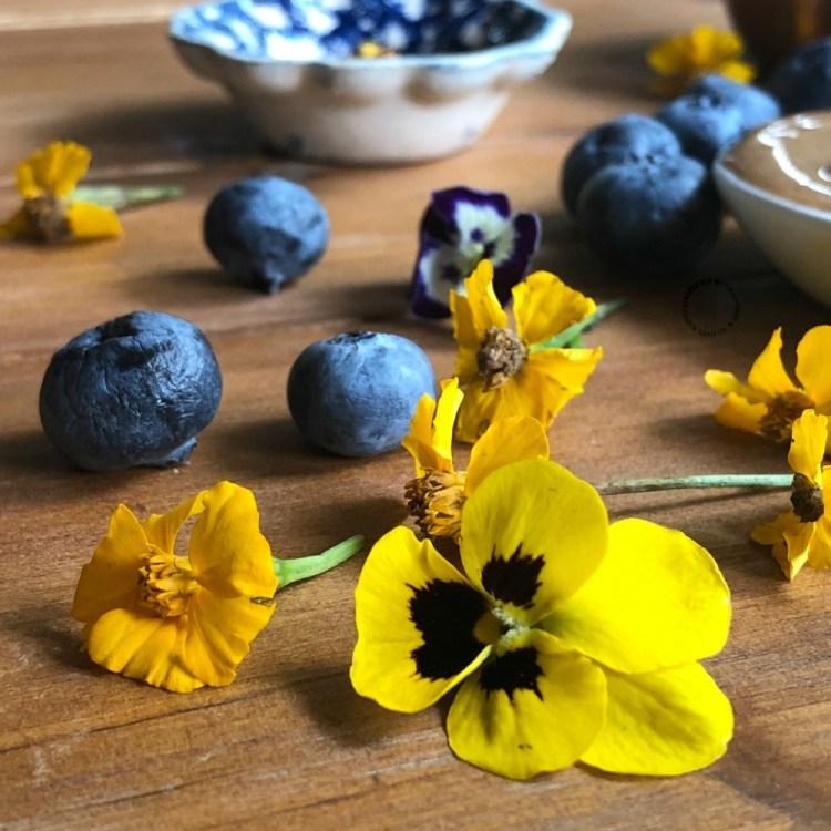 Garnishing with lemon marigold flowers and violas