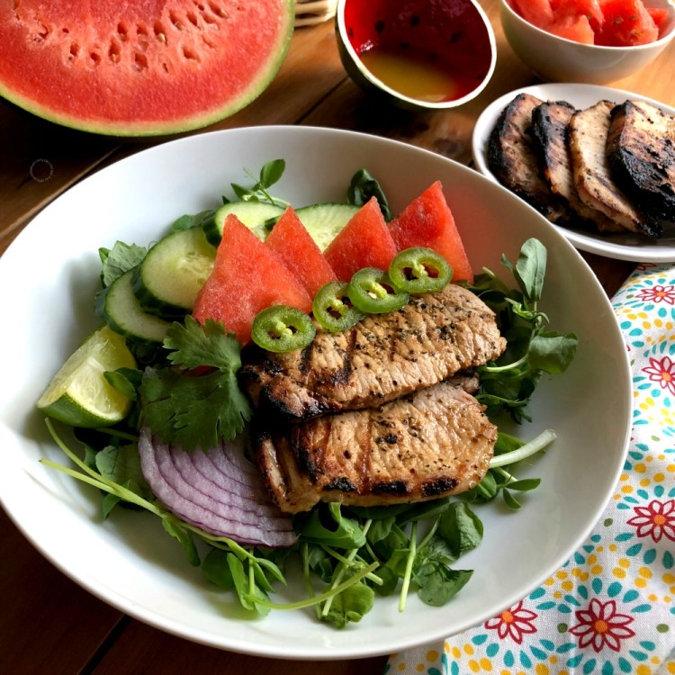 Drizzle the watermelon salad with grilled pork chops with a fresh lime olive oil dressing
