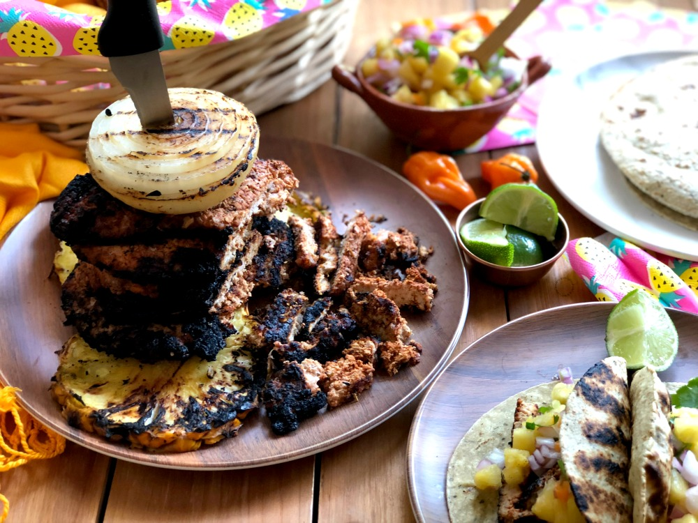 Stack the grilled pork loin steaks for a traditional tacos al pastor experience