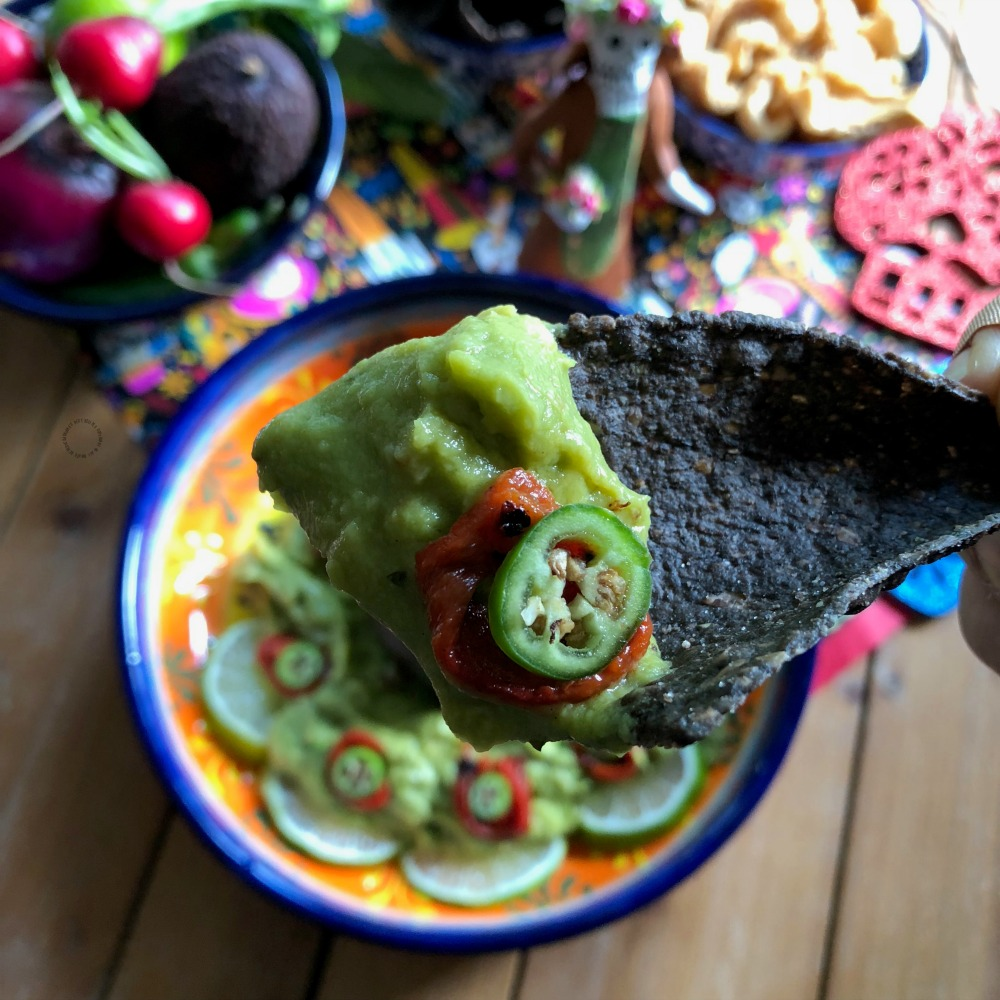 Enjoy the skull guacamole with blue corn chips