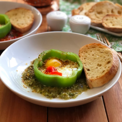 Bell Pepper Egg Breakfast Recipe made with bell peppers rounds cut simulating a flower, eggs and served with a salsa verde or red Mexican salsa. Paired with buttered toast.