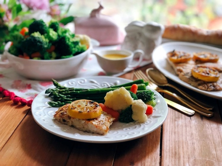 Grilled Pacific Snapper Recipe served with a side of veggies, asparagus, and a French style butter sauce
